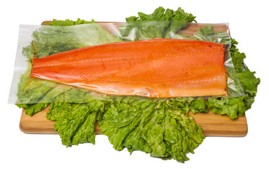 smoked fish with salad on chopping board