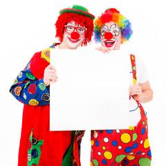 fröhliche clowns mit angebotstafel