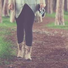 Beautiful woman walking in the park, toned image