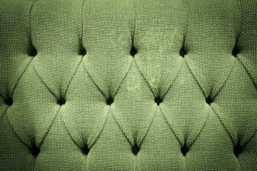 Green Fabric sofa button pattern baclground