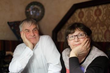 Pensive senior couple