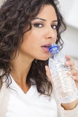 Woman Drinking Bottle of Water