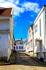 A narrow street covered with brick, between the houses, Norway