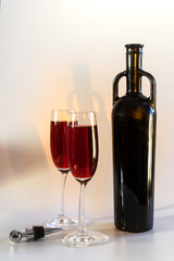 original red vine bottle and two wine glasses