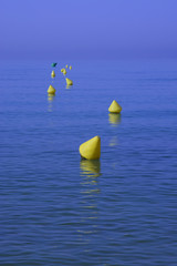 Yellow buoys blue sea