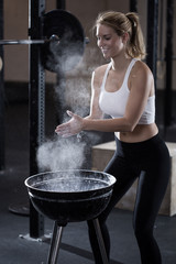 Woman during preparing for weight lifting