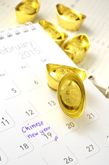 Chinese new year and gold ingots on calendar