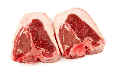 Two cuts of raw uncooked lamb chops