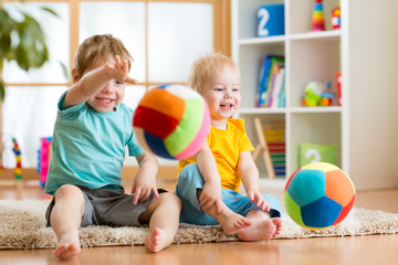 kids playing with ball indoor