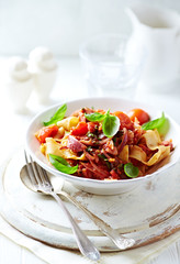 Pappardelle pasta with cherry tomatoes and fresh basil