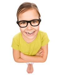 Portrait of a little girl wearing glasses
