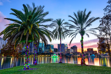 Orlando, Florida, USA Cityscape and Palm Trees at Eola Lake
