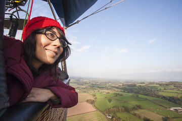 Woman travelling in a hot air balloon.
