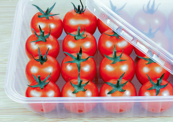 tomatoes in a plastic container
