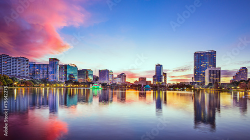 Orlando, Florida, USA downtown skyline at Eola Lake