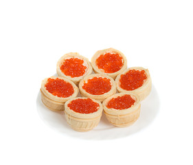 Red caviar in tartlets, isolated on white