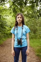 A young girl, a birdwatcher.