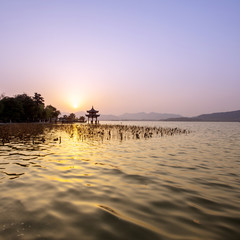 skyline and lake at sunset in hangzhou,china