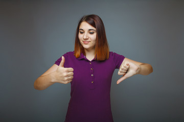 Girl 20 years of European appearance haired showing thumbs up si