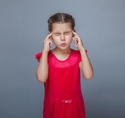 girl child migraine headache on a gray background