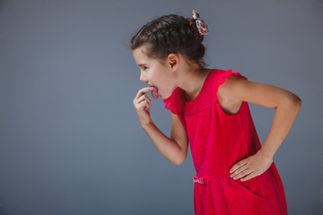 girl put finger her mouth sick in a red dress