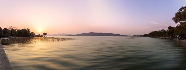 panoramic skyline and lake at sunset in hangzhou,china