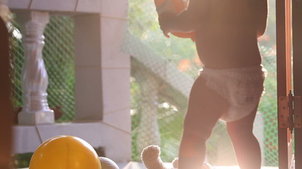 child playing with toys and looking at it is backlit