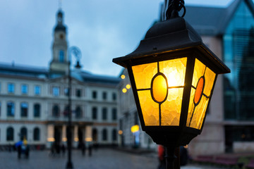 Yellow light on the background of the Town Hall in Riga