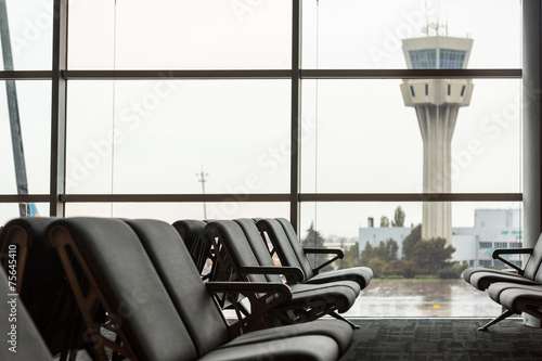 Empty Chairs in a Waiting Room at Airport - 75645410