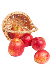 Red apples fell out from the basket