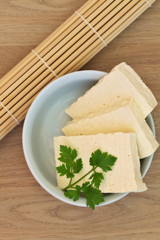 Sliced Tofu on a wooden background