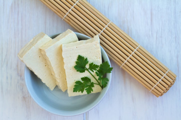 Sliced Tofu on a vintage wooden background