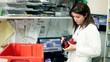Pharmacist tagging medicine in pharmacy