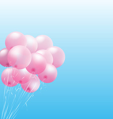 Pink inflatable air balls on sky background