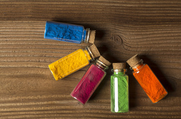 Glass bottles filled with coloured powder