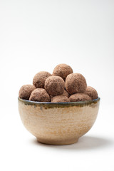 Chocolate truffles in a bowl on an isolated background