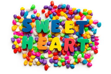 sweet heart word in colorful stone