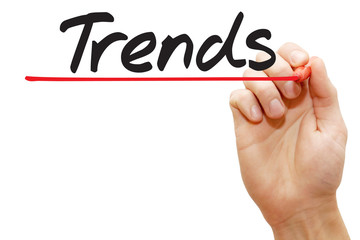 Hand writing Trends with red marker, business concept