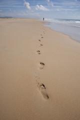 far woman walking at beach