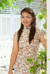 Chinese woman dress traditional cheongsam ,close up portrait wit