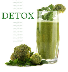 Glass of green vegetable juice with broccoli and parsley