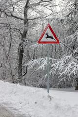 Traffic sign warns deer crossing