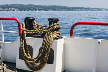 Boat with mooring rope around a bollard.