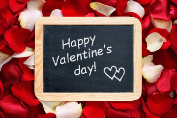 Happy Valentines day! text on blackboard