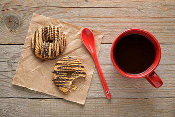 Coffee cup and cookies on wooden background