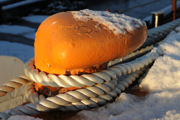 Orange mooring and white rope