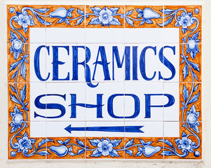 Elegant Ceramics Shop sign with directional arrow
