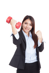 Young Asian businesswoman with red dumbbell