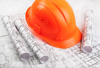 Architectural blueprint rols and helmet