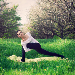 beautiful girl is engaged in yoga in the forest